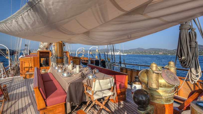 open dining area on a yacht for charter S/Y TRINAKRIA