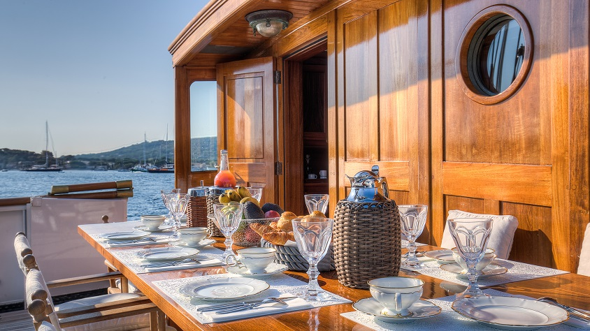 luxury dining area on a deck on a S/Y TRINAKRIA for charter