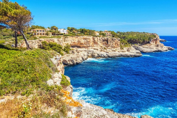 Rugged cove on luxury yacht charter Spain