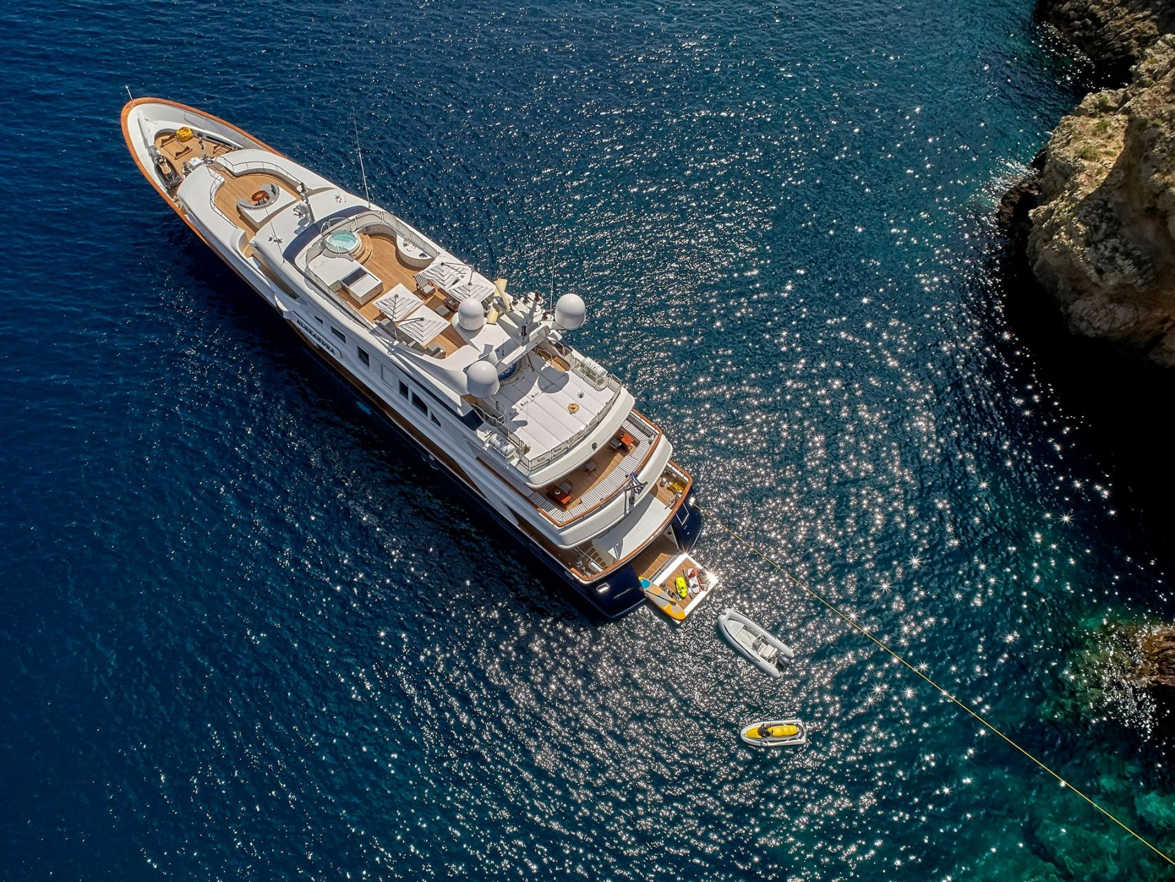 m/y alexandra yacht for charter anchored bird view