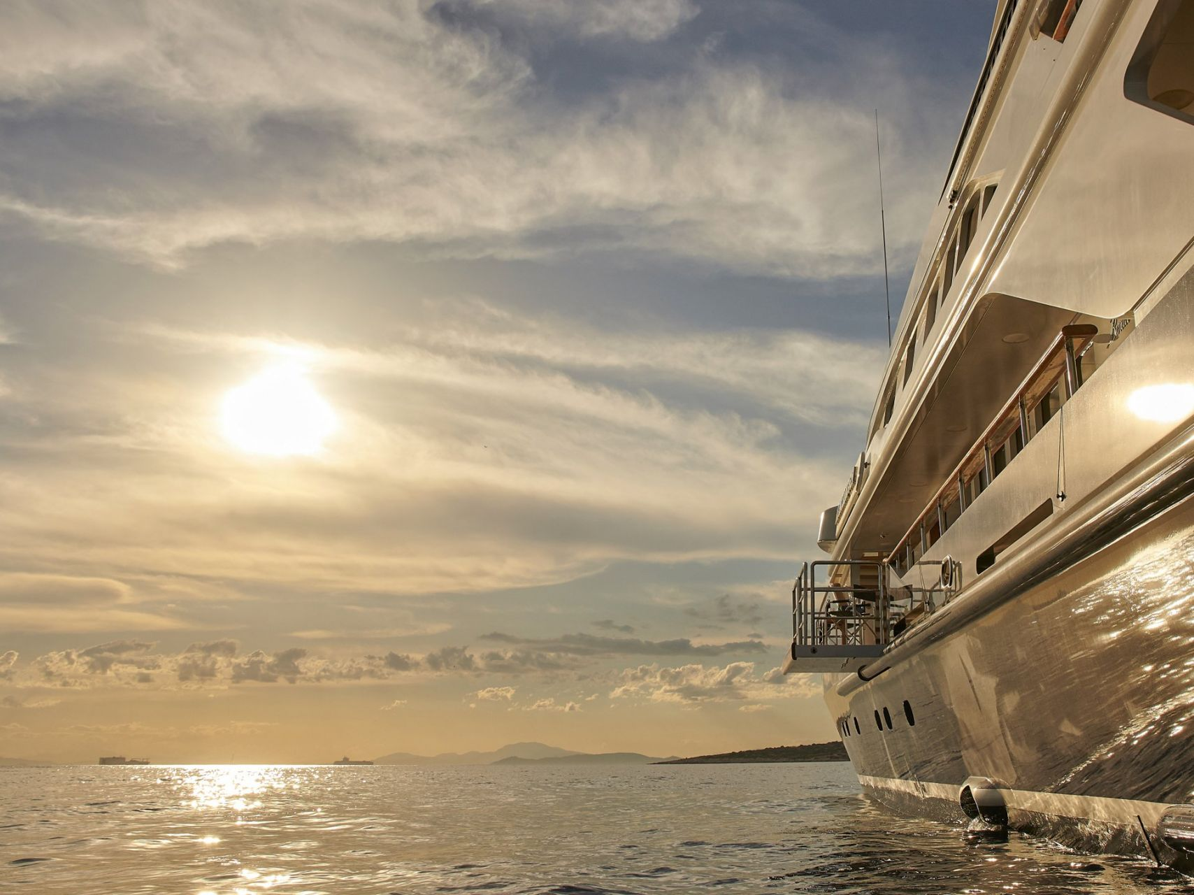 m/y alexandra yacht for charter sunset side view