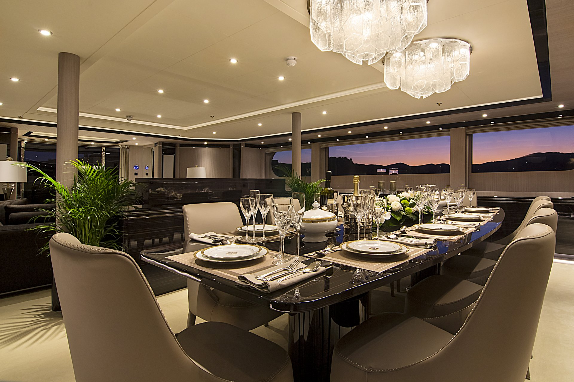 m/y invader yacht for charter set indoor dining table