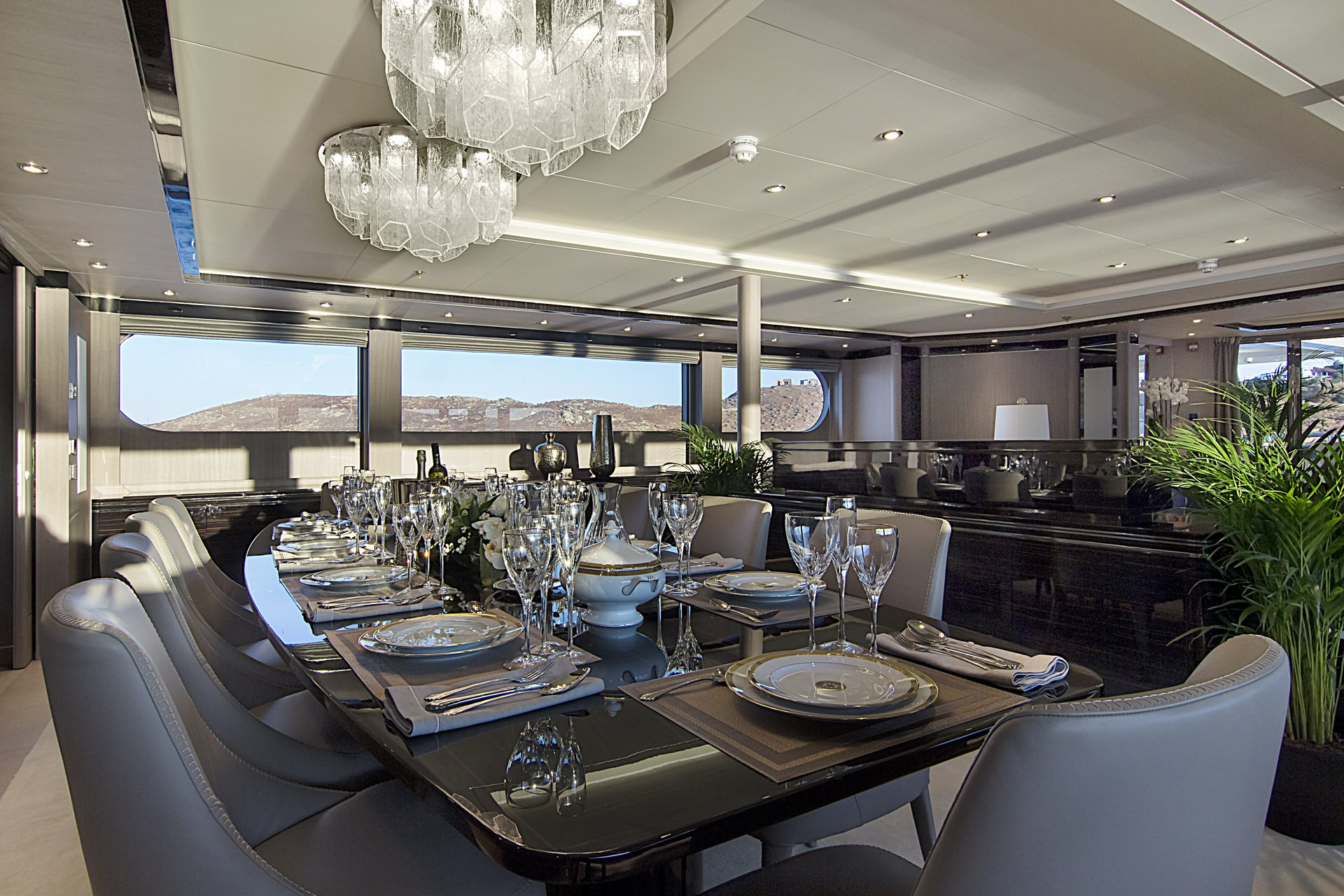 m/y invader yacht for charter indoor dining area