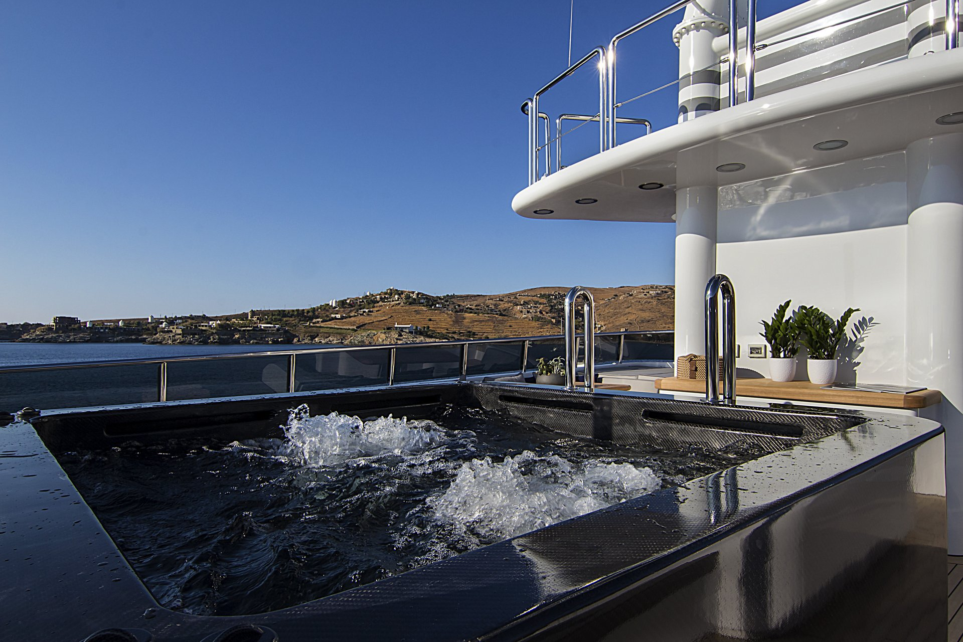 m/y invader yacht for charter hot tub