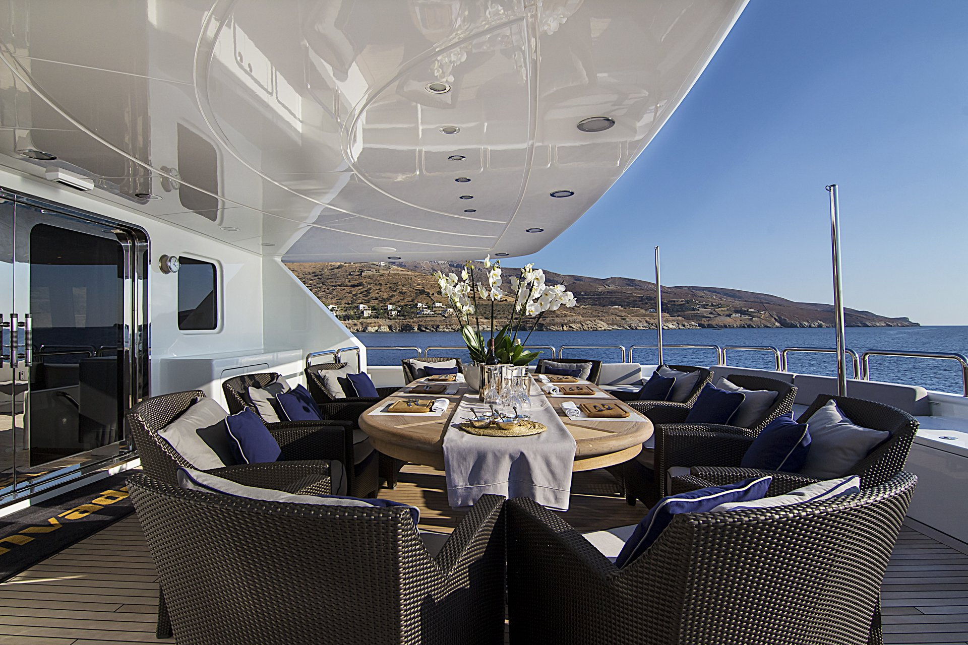 m/y invader yacht for charter outdoor set dining table