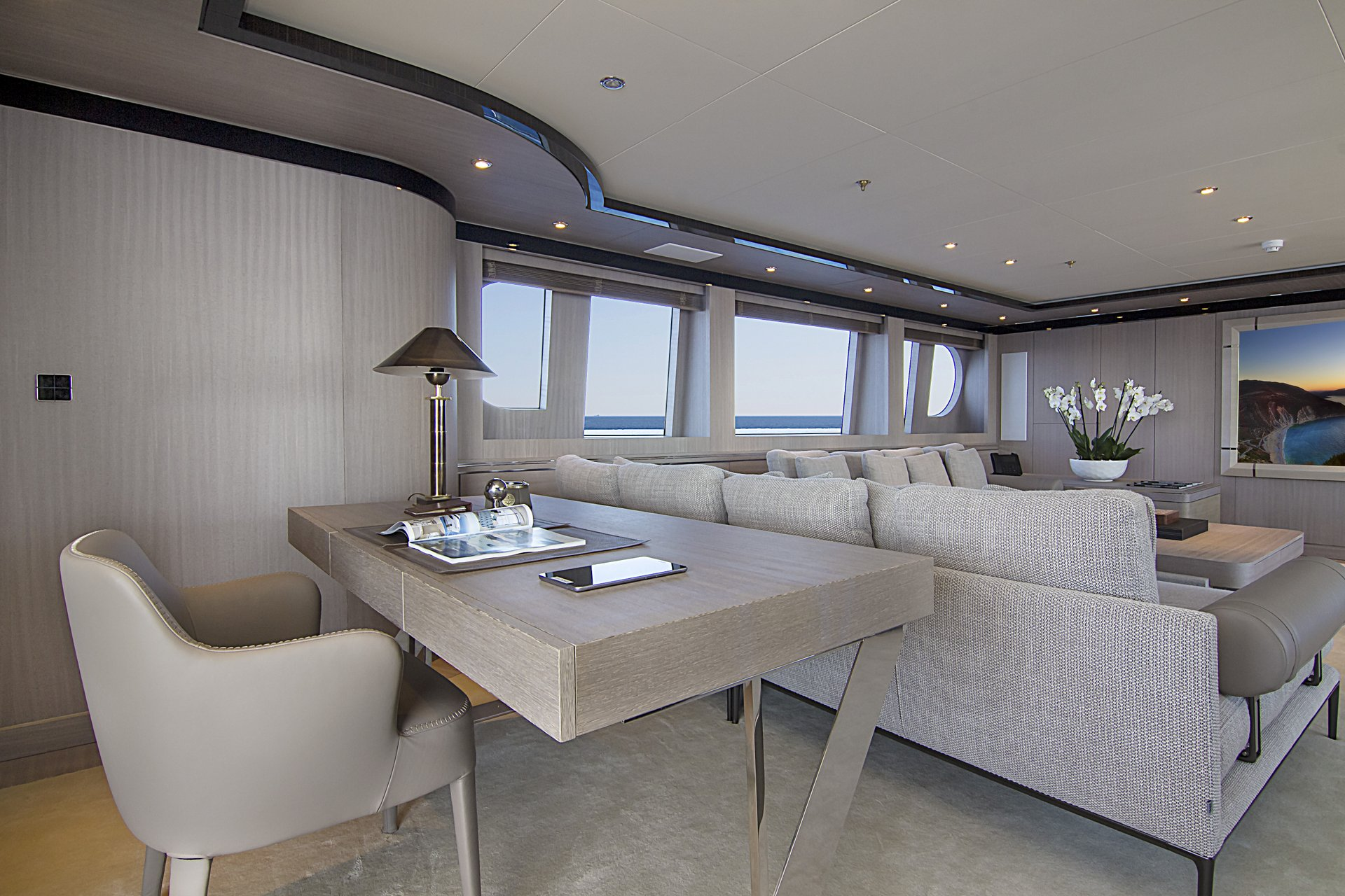 m/y invader yacht for charter lounge desk